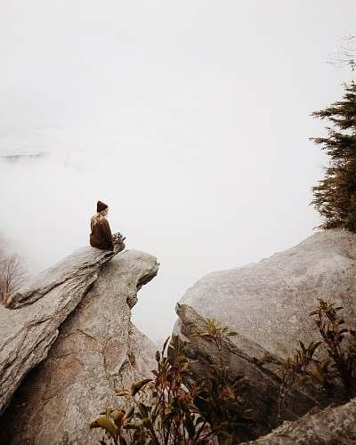rock woman sitting on brown rock girl