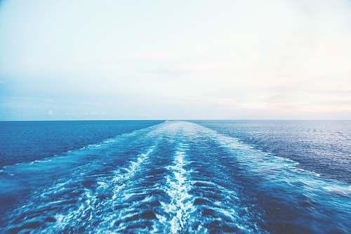 water blue ocean water under white sky sea