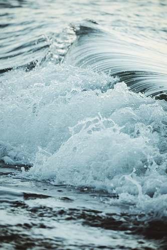sea close up photography sea waves splashing on shore water
