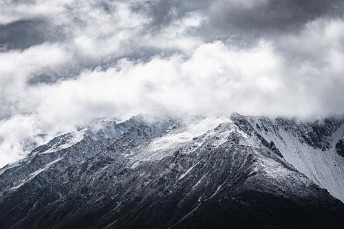 mountain aerial photography of gray and black mountain mountain range