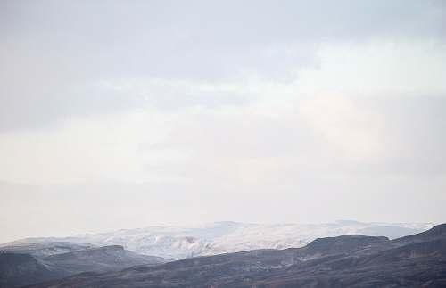 mountain mountain view under white skies nature