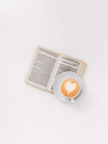 text cappuccino on brown book reading