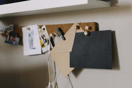white brown cork board with papers shelf