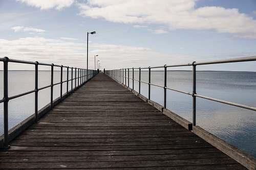 walkway brown wooden dock boardwalk
