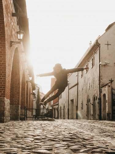 walkway man doing skateboard trick flare