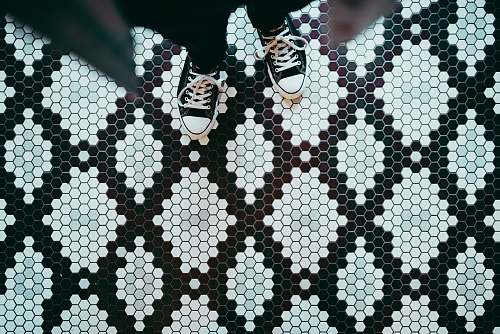 shoe person standing wearing black sneakers tiles