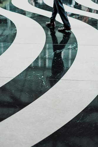 photo road Swirling black and white pattern on a marble floor street free for commercial use images