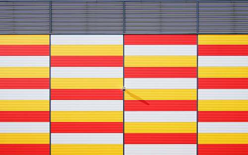 architecture white, red, and yellow striped bars background