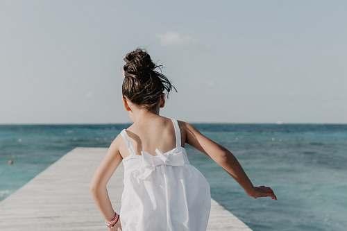 person girl running on dock under white sky human