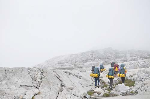 human group of people hiking on moutain person