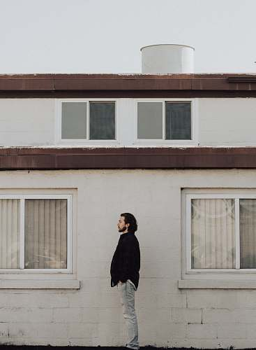 human man standing on front of residential building person