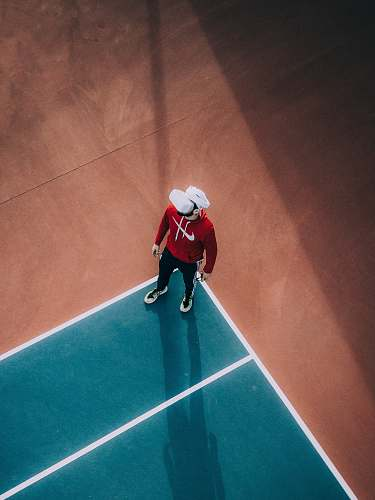 human man standing on lawn tennis court person