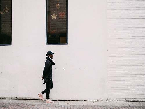 person man walking on street human