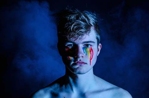 person photo of man crying with colored tears human