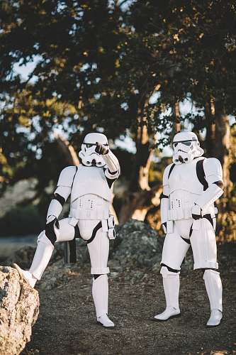 person two Star Wars Stormtrooper action figures on gray surface outdoors human