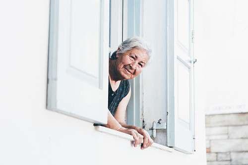 human woman peeping at window person