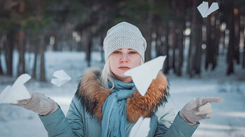 human woman surrounded by flying paper plane person