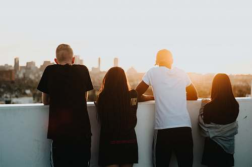 human four person looking at the city people