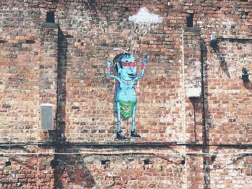brick illustration of man in green bottoms human