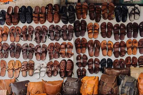 human pairs of assorted sandal lot on white textile people