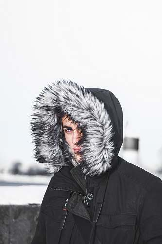 human person covering face using hoodie people
