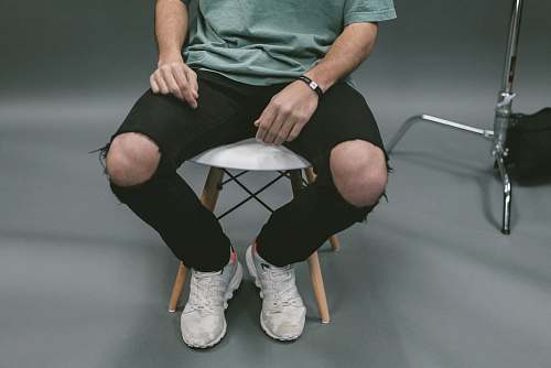 people person sitting on white wooden stool human