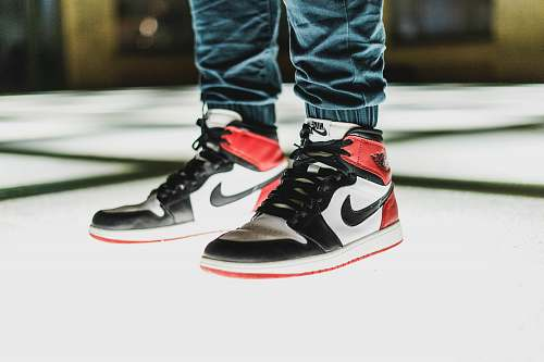human person wearing black-white-and-red Air Jordan 1's people
