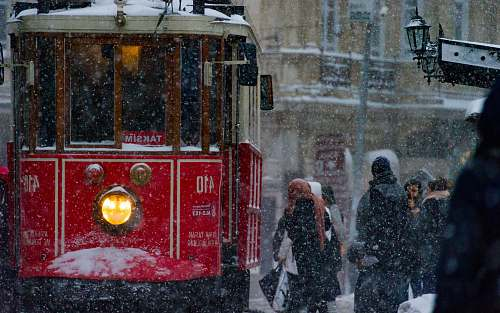 istanbul photo of people near tram train turkey