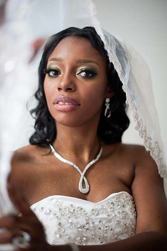 human selective focus photo woman wearing wedding veil people