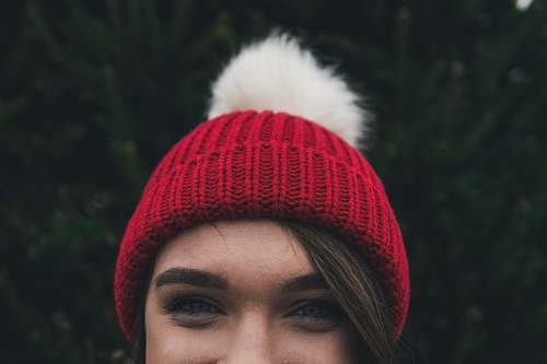 hat woman wearing red bobble hat beanie