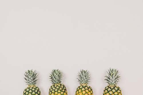food four pineapples on white background fruit