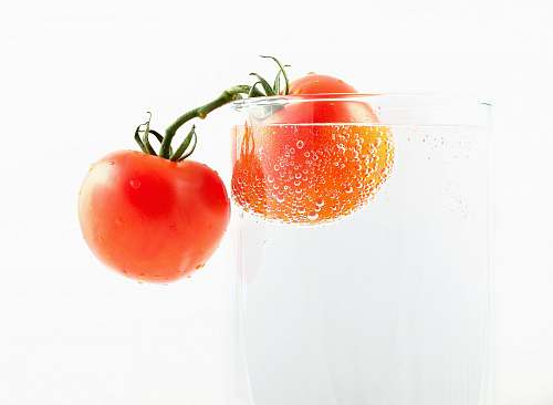 tomato tomatoes on clear drinking glass food