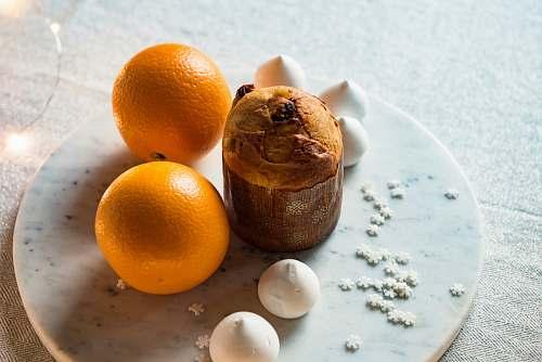 food two orange fruits on white plate orange