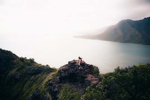 nature woman sitting on cliff outdoors