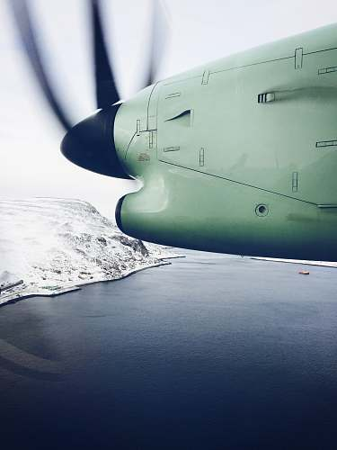 norway white plane flying over lake hammerfest