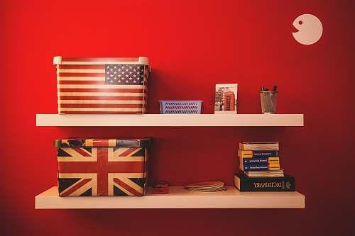 books two gift boxes on floating shelf shelf