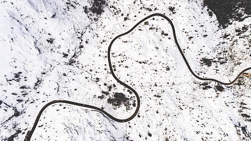 snake snow capped mountain during daytime animal