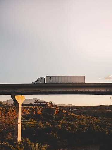 freeway white truck overpass