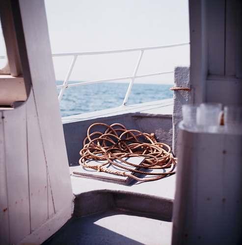 boat brown rope sail