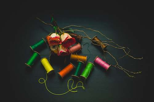 color flat lay photo of threads thread