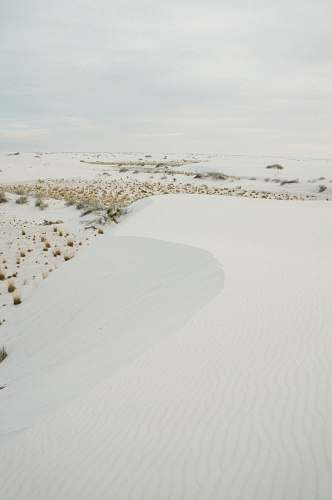 dune snowfield during cloudy sky white sands national monument