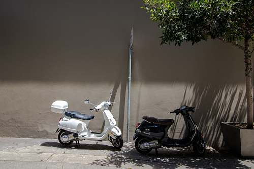 moped black and white motor scooter transportation