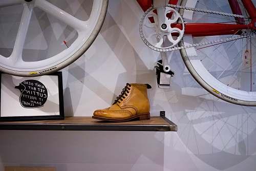 footwear unpaired brown leather wingtip shoe on floating shelf clothing