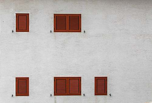 window gray building with brown louvered windows curtain