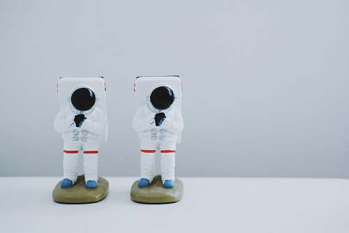 statue two spacesuit figurines on white surface toy