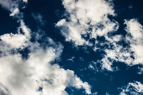 cloud low angle photography of blue sky clouds