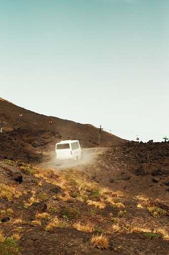 etna white van in a hill during daytime sicily