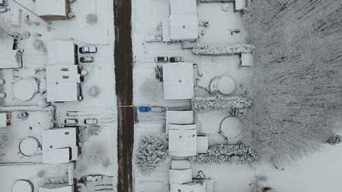 grey birds eye photography of snow covered residential area aerial view