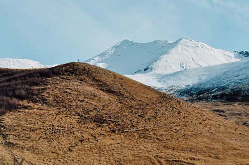 mountain brown mountain near mountain covered with snow landscape