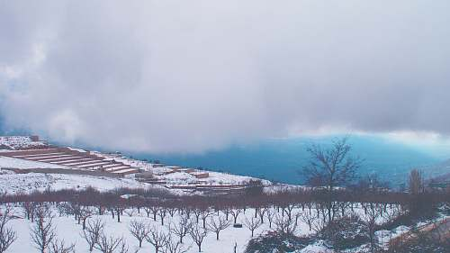 blue snow covered ground under white clouds winter